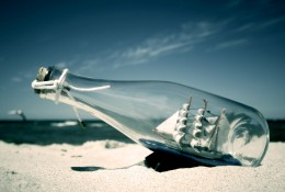 ship in bottle on a beach